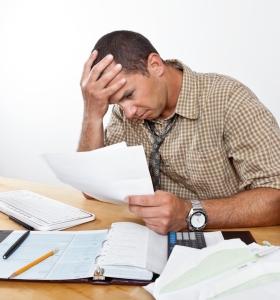 frustrated man paperwork