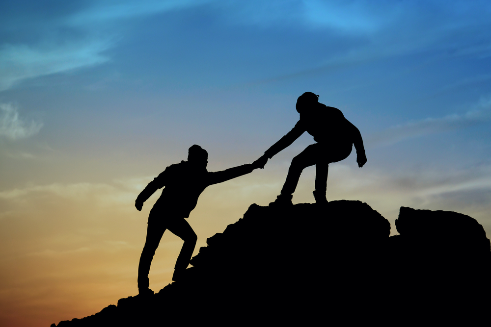 mountain climbers helping hand